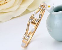 Egymasba-fonodo-hurok-mintas-arany-ezust-karperec
